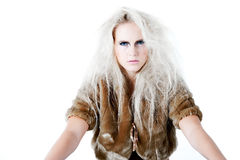 What do you think will be my next move. Model with wild white hair in a waiting pose with a fierce look. Usable for health and beauty, cosmetics, love, hate and stock photos