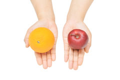 What do you want. A female's hands gesture offering orange or apple Stock Photos
