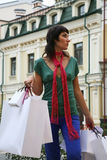 What else to buy?. Young woman with a lot of shopping bags Royalty Free Stock Photography