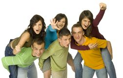 What a fun!. Group of 6 happy teenagers. There're 3 couples. Boys are pick-a-backing girls. White background Stock Image