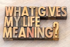 What gives my life meaning?. A question in vintage letterpress wood type blocks stock photo