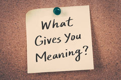What gives you meaning?. Concept word text message on bulletin board stock images