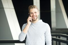 What great news. Man with beard call smartphone urban background. Guy happy smile use smartphone to communicate friends. Man use mobile phone call friend royalty free stock photos