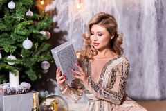 What a great surprise Beautiful young woman opening a gift box and smiling. fashion studio photo of beautiful charming woman with stock photography
