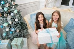 What a great surprise. Small cute girls received holiday gifts. Best toys and christmas gifts. Kids little sisters hold. Gifts boxes interior background royalty free stock photo