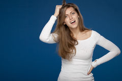 What happend?!. Portrait of excited young female holding her head Royalty Free Stock Photography