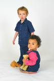 What have we done?. A little boy and girl looking guilty with their teddy bears royalty free stock photography