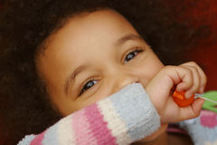 What Have I done?. A beautiful young mixed race little girl with a mischievous look on her face Royalty Free Stock Photo