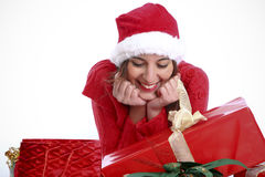 What Have I Got For Christmas?. Happy Cute Woman Looking At Some Christmas Presents stock image