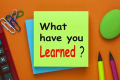 What have you Learned. ? written on note with pencil and calculator aside. Educational concept Royalty Free Stock Image