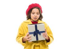 What is hidden under the wrapper. small parisian girl. pleasure shopping. childrens day. France style. child with. Present box. beauty and spring fashion stock photos