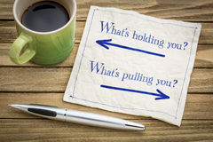 What is holding and pulling you? Napkin concept. Royalty Free Stock Photo