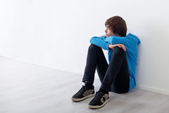 What if ... Serious teenager boy thinking and daydreaming while sitting at home Royalty Free Stock Image