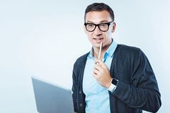 Thoughtful mature man thinking over project Royalty Free Stock Images