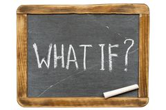What if quest fr. What if question handwritten on vintage isolated slate chalkboard with piece of chalk Stock Photo