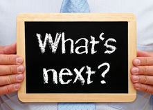 Free What Is Next - Manager Holding Chalkboard With Text Stock Photos - 97043113