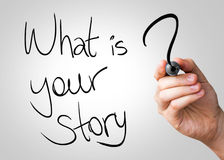 What Is Your Story Hand Writing With A Black Mark On A Transparent Board Stock Photo