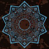 Oriental mandala motif. What is karma?. What is karma? Oriental blue mandala motif round lase pattern on the black background, like snowflake or mehndi paint in Stock Photography