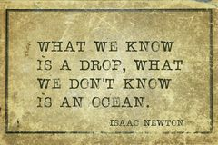 We know Newton. What we know is a drop - ancient English physicist and mathematician Sir Isaac Newton quote printed on grunge vintage cardboard Stock Images
