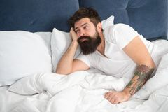What a long night. Sleep disorders concept. Man bearded hipster having problems with sleep. Guy lying in bed try to. Relax and fall asleep. Relaxation royalty free stock images