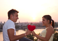 What a love. Lovely couple holding a heart Stock Photos