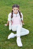 What makes child happy. Girl braids hairstyle and modern headphones enjoy relax. Secrets to raising happy child. Girl royalty free stock images