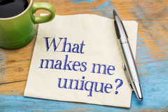 What makes me unique? Question on napkin. Stock Photos