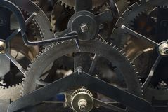 What makes it tick. The interior gears and timing mechanism of an antique printing press royalty free stock photography