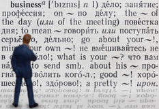 What is meaning of the word business ?. Figure of businessman who thinks about meaning of word business. Written in russian language royalty free stock photo