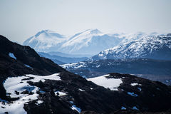 What are men to rocks and mountains?. View from atop Mount Ulriken in Bergen, Norway Royalty Free Stock Photo