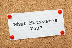 What Motivates You?. The question typed onto a piece of lined paper pinned to a cork notice board Stock Photos