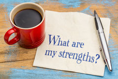 What are my strengths question. Handwriting on a napkin with a cup of coffee Stock Images