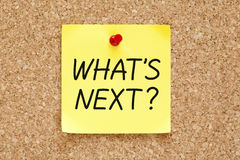 What is Next Sticky Note. What's Next, written on an yellow sticky note pinned on a cork bulletin board royalty free stock images