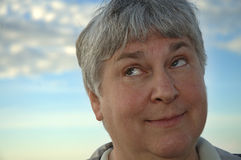 What now?. A gray-haired woman rolls her eyes royalty free stock photography