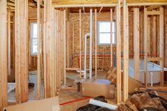 What is now a construction site will soon be someone& x27;s home. Wood Building frame Stock Photography