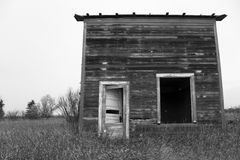 What Once Was. A small shack left abandoned in a corn field Royalty Free Stock Images