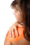What A Pain!. A young woman holds her shoulder in pain! Colored as a visual aid Royalty Free Stock Photography
