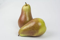 What a pear. Two pears one standing with one laying down  in front Royalty Free Stock Image