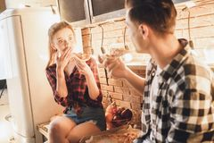 What, realy? Amazement woman with shocked face eating pizza royalty free stock photo