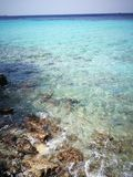 Rocky Sea, Ocean and Blue Skies. What about relaxing in the cristal-clear water of Curazao`s beach Stock Photos
