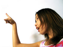 What's That?. Asian girl pointing above Royalty Free Stock Images