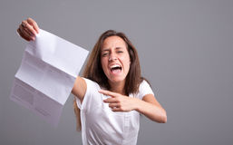 What's this?! Angry girl and bad news Stock Photography
