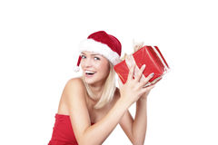 What's In The Box. Cute Blond Santa Girl With A Present Box Royalty Free Stock Photography