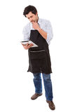 What's for dinner?. Young man searching for a new recipe over the internet Royalty Free Stock Image