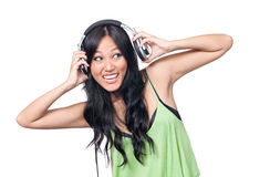 What's that I'm hearing. A young Asian girl looking excited putting on a pair of headphones Stock Photos
