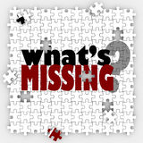 What's Missing Question Words Puzzle Holes Gaps Incomplete Pictu. What's Missing words and question mark on a puzzle with pieces not filled in, asking you to Stock Photo