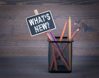 What`s New. A small blackboard chalk and colored pencil on wood background.  stock photo