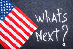 What`s next on the chalk board and US flag Royalty Free Stock Photography