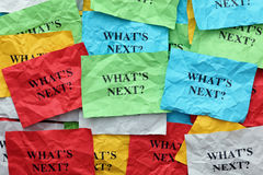 What's next?. Crumpled colorful paper notes with the question What's next Royalty Free Stock Image