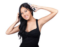 What's that sound. A smiling Asian girl putting on a pair of headphones Stock Images